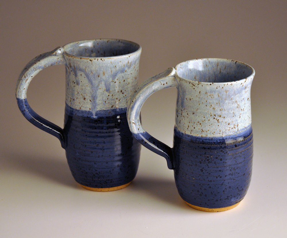 two light and dark blue cups