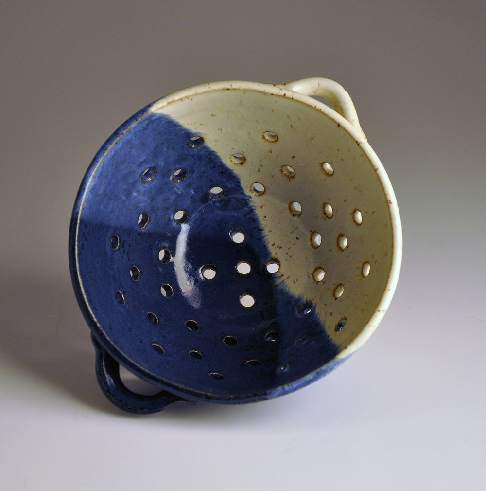 small blue and white collander