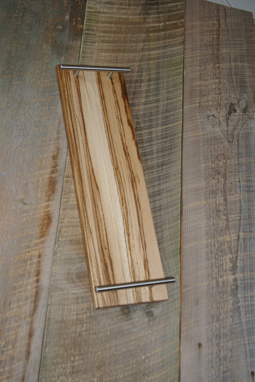 ZEBRA WOOD TRAY$60 - #114 ZEBRA WOOD TRAY WITH BRUSHED NICKLE HANDLESSIZE 5X20X 3/4