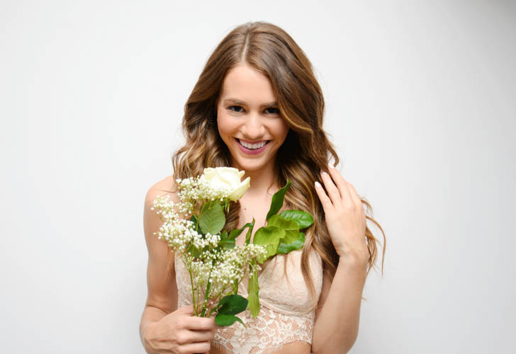 Girl smiling with roses valentine's day