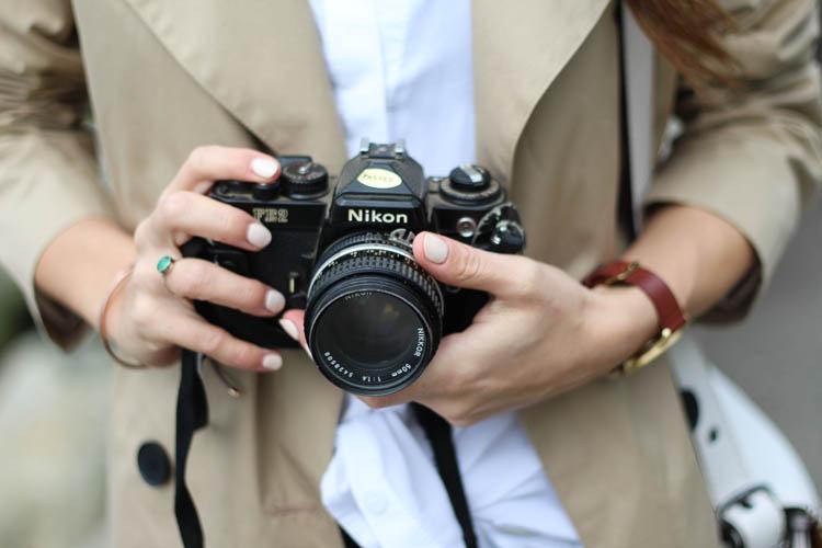 Holding Nikon camera
