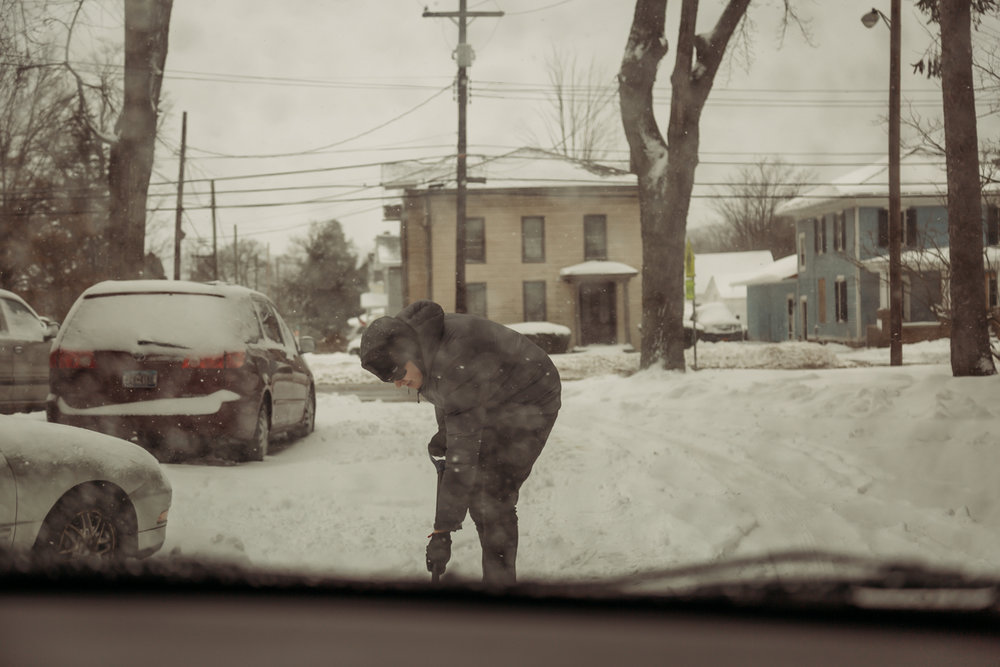 McKay shoveling snow
