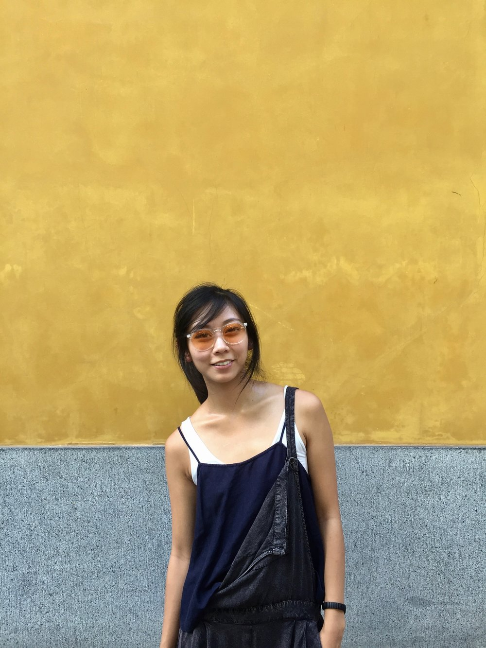 style travel blogger in china yellow background contrast