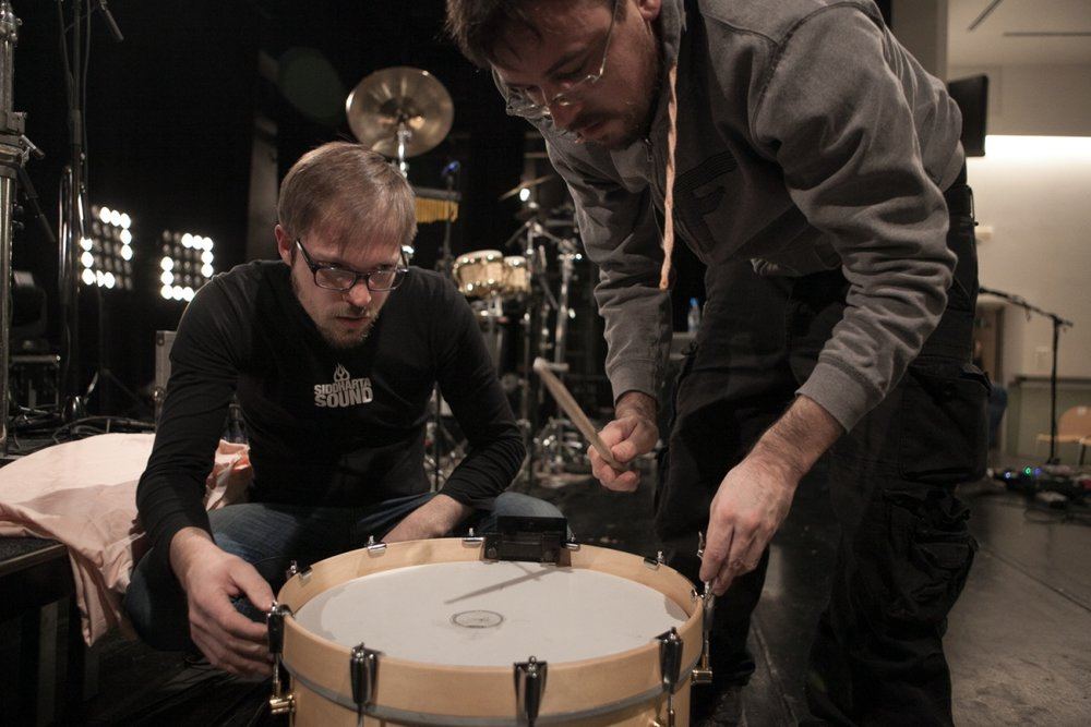 Tuning the kick drum before the show. By carefully adjusting the sound at the source I can save myself a lot of trouble down the road. With  Siddharta  drummer Bostjan Meglic, photo credit Tomaz Santl.