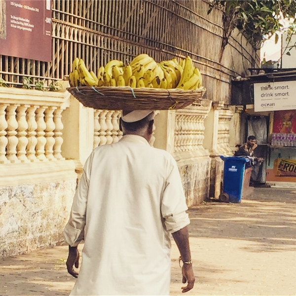 Man carrying banana on the streets of Mumbai