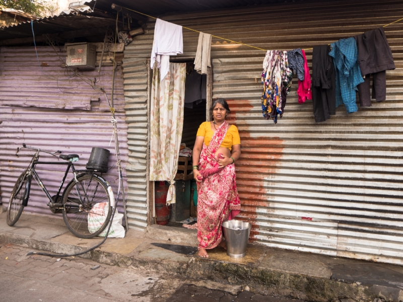 Woman washing cloths on the streets, early morning, Pune