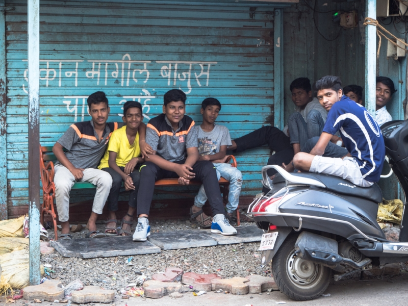 Boys posing for a photo on the streets of Pune