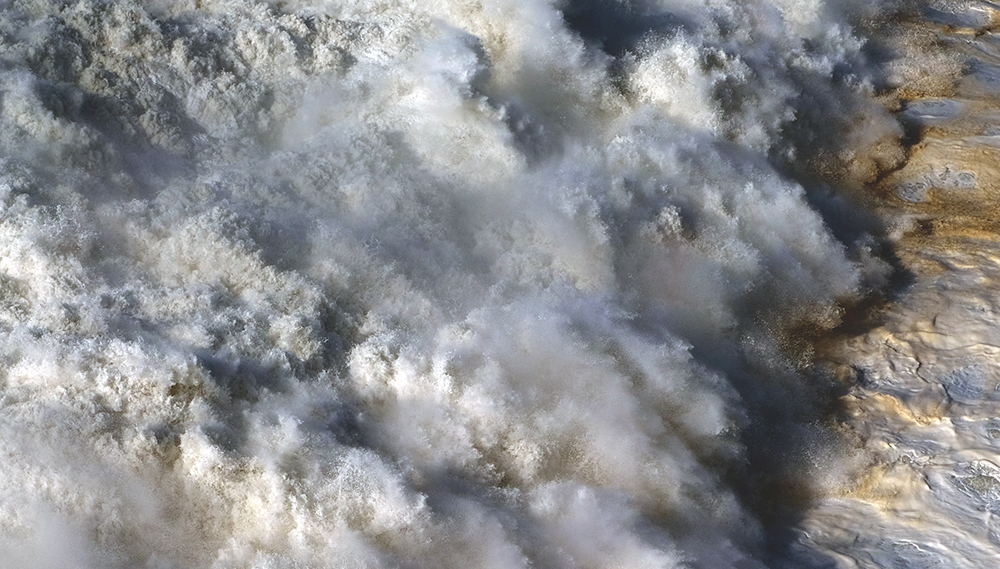 timeline-photography-nazare-broken-wave.jpg