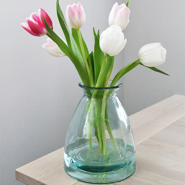 2. FLOWERS  - If you have planned to buy her a bouquet of flowers, why not complete the surprise by ordering one of our vases? That way, she will have something lovely in which to display her beautiful blooms.Featuring our Wells Recycled Glass Vase.