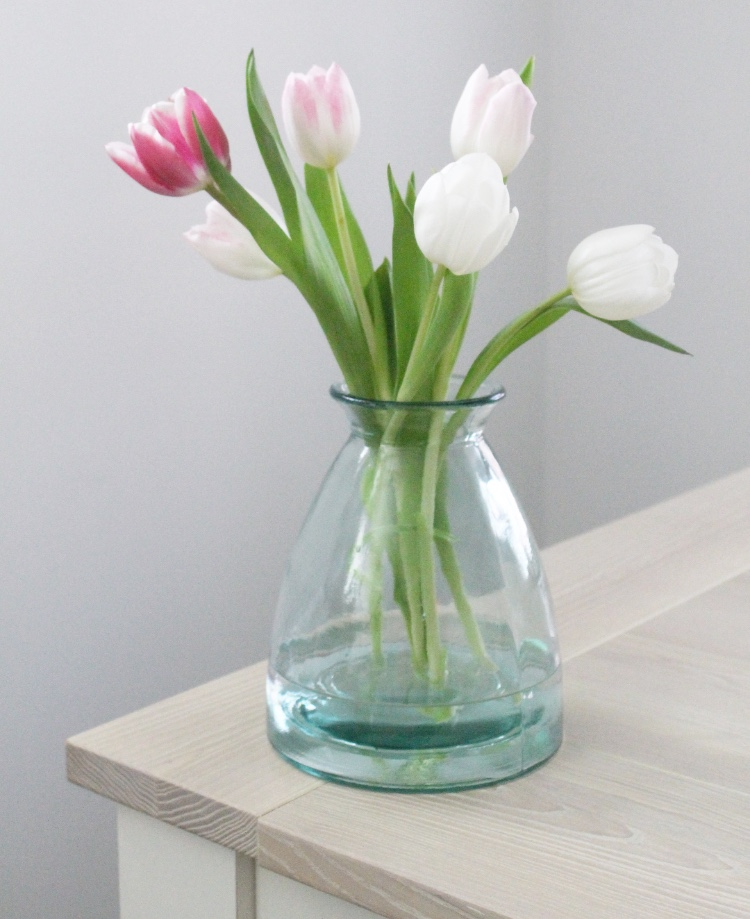 Fill Your House With Blooms - Flowers give any room a new lease of life. Try adding a bunch of tulips freshly cut from the garden and arranged loosely in a beautiful vase, or hyacinth bulbs potted into plant pots or jam jars will instantly fill your home with a sweet scent!The vase we have used - Wells Recycled Glass Vase