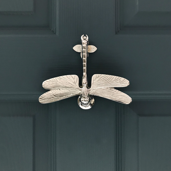Dragonfly - This intricately detailed Dragonfly Door Knocker is hinged at the end of the tail using bolts that come provided with the knocker. The head and the tail are the only parts that touch the door. The dragonfly's wings hover over the door while the head of the dragonfly is used to tap onto the striking plate.Size: 160mm wide x 130mm high x 30mm projection. The wings stand 18mm away from the door. The door knocker is attached by 2 bolts that are approximately 95mm apart. (Bolts are included)Boxed weight: 350gAvailable In: Chrome, Nickel, Brass(Photo of Nickel Dragonfly Door Knocker)