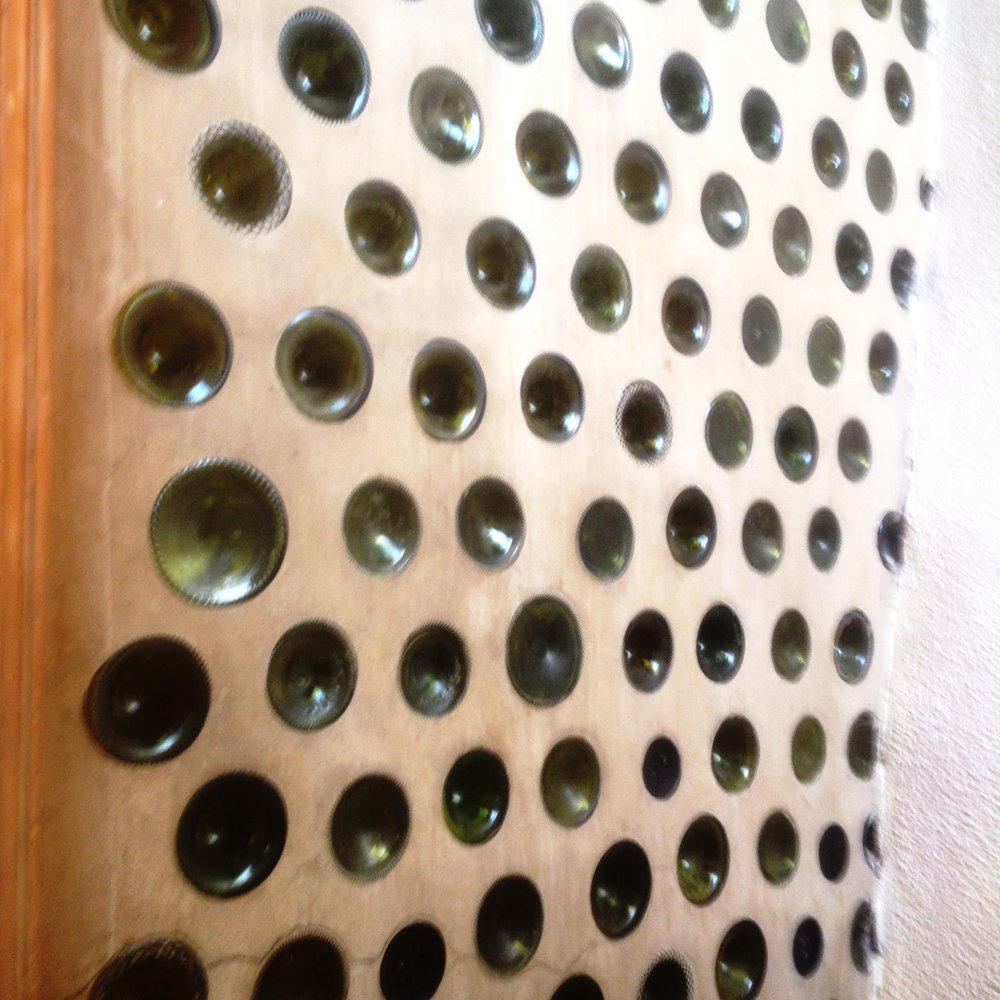 Bottle wall - This bottle wall is from a simple survival Earthship, off-grid home in Taos, New Mexico.