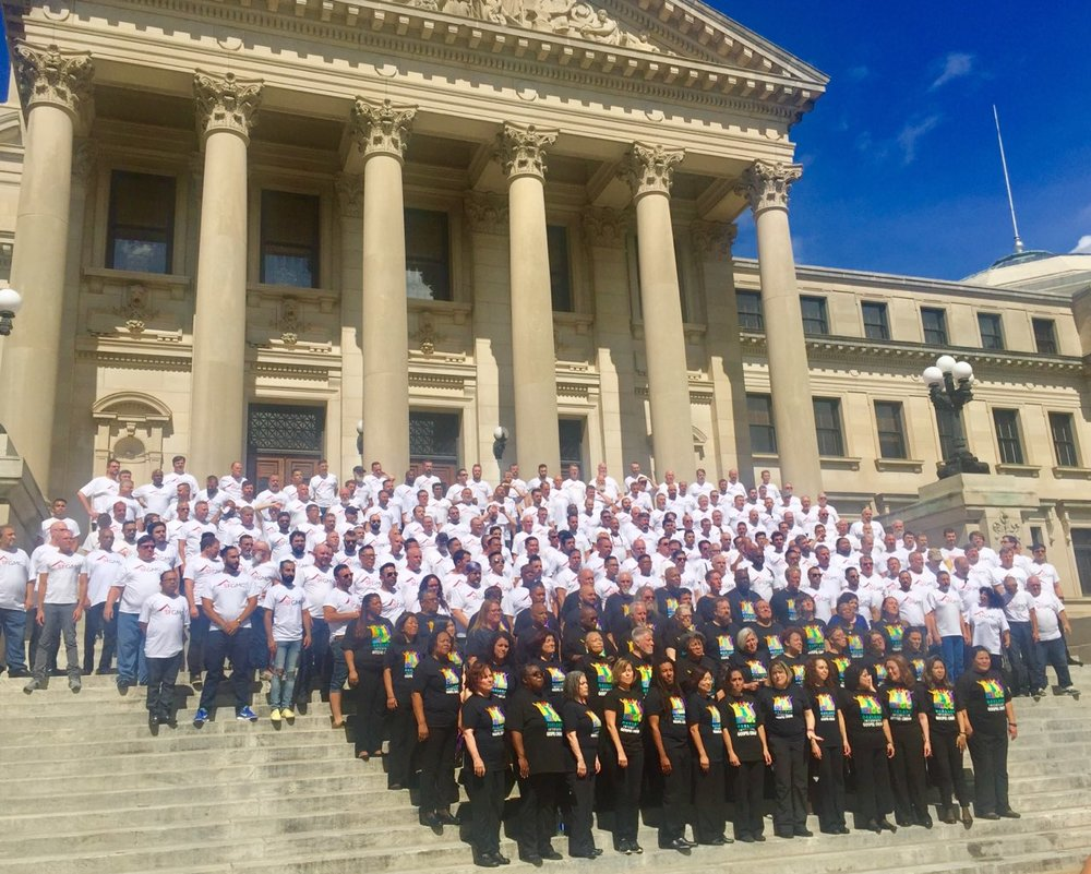 COIL led the Entourage on the Lavender Pen Tour, sponsoring the San Francisco Gay Men's Chorus and Oakland Interfaith Gospel Choir on an eight day journey through five Southern states, singing to thousands.  Shown here on the steps of the Capitol in Jackson, Mississippi.