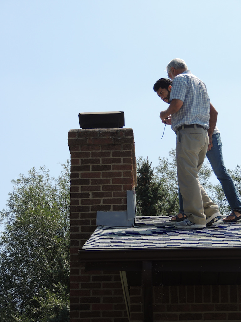 Inspecting the chimney.jpg