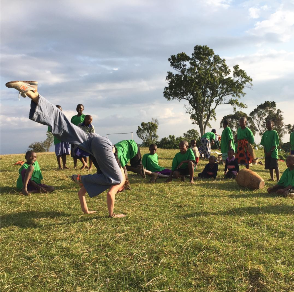 Practice Yoga Manager, Mollie Graves,  teaching yoga to children in Uganda