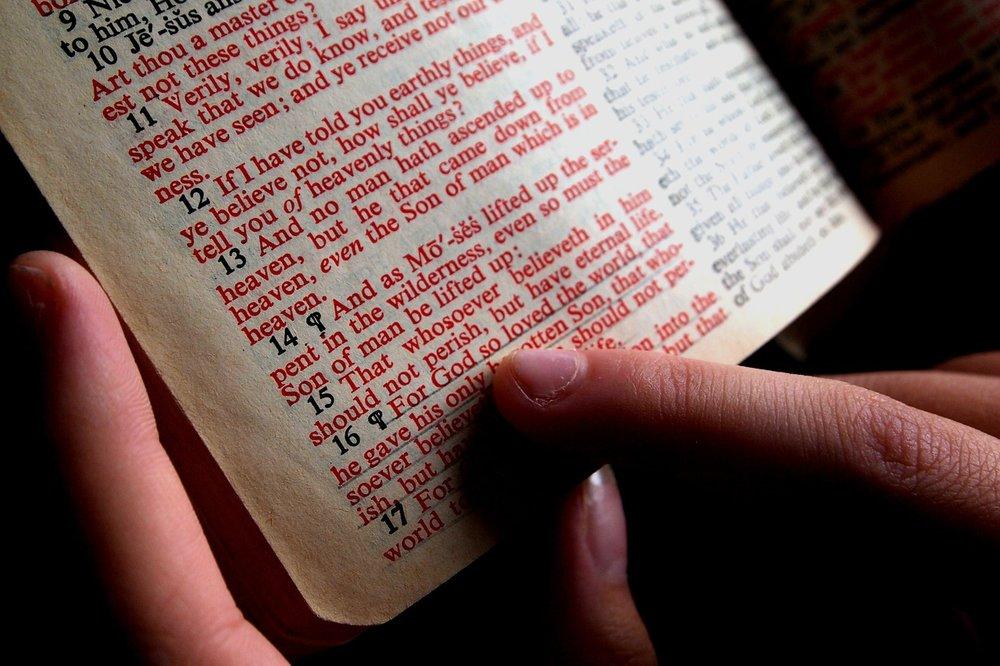 pixabay.com/en/bible-hand-designate-read-1089968/