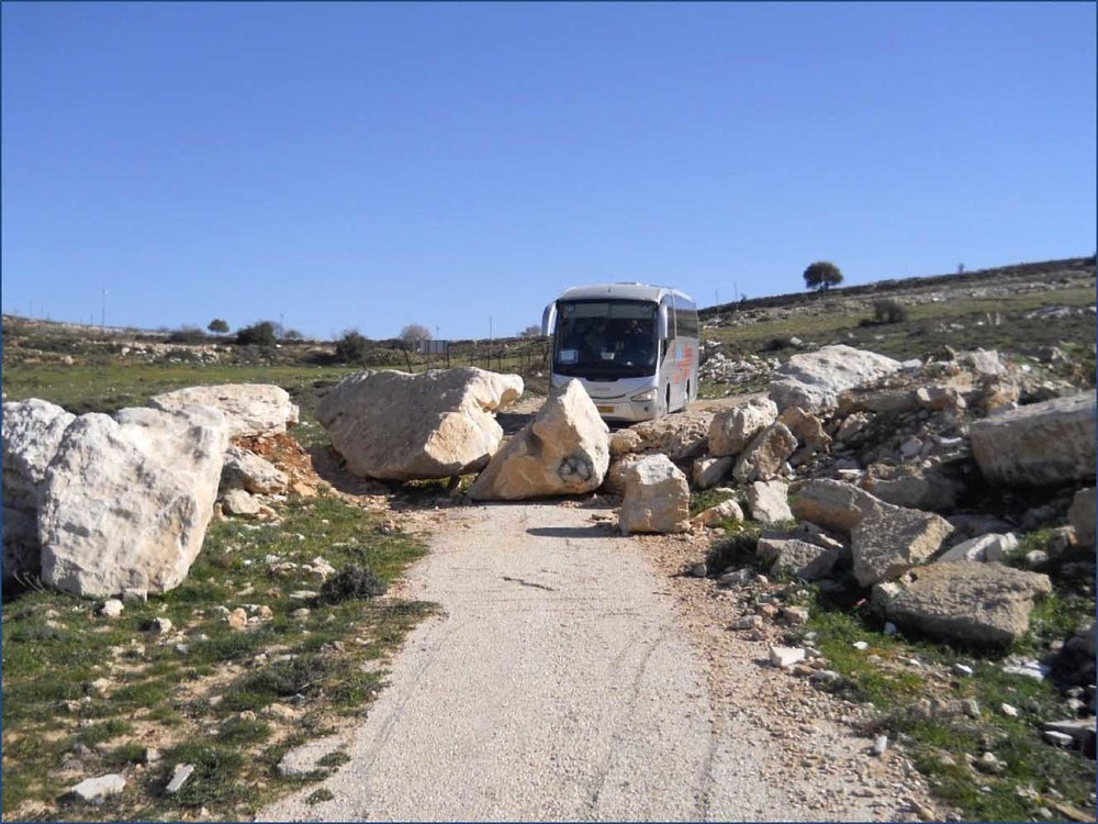 Boulders blocking entrance to the Nassar family farm. Photo Credit: Tom Bell