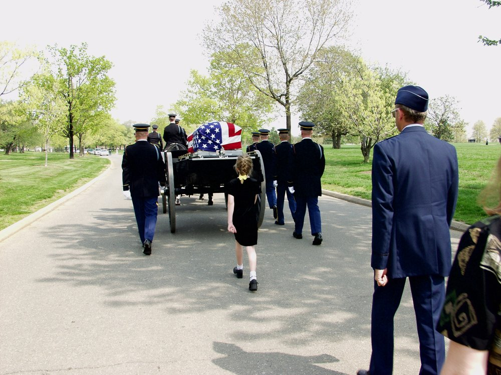 My father, Joseph Folio, passed away in February, 2003, and is buried at the Arlington National Cemetery. He had a distinguished career in the army. My mother passed away in October, 2004 after a long struggle with Alzheimer's disease. The photo above (taken by Aleck Brinkman) shows Lydia and Les following the caisson at my father's funeral.