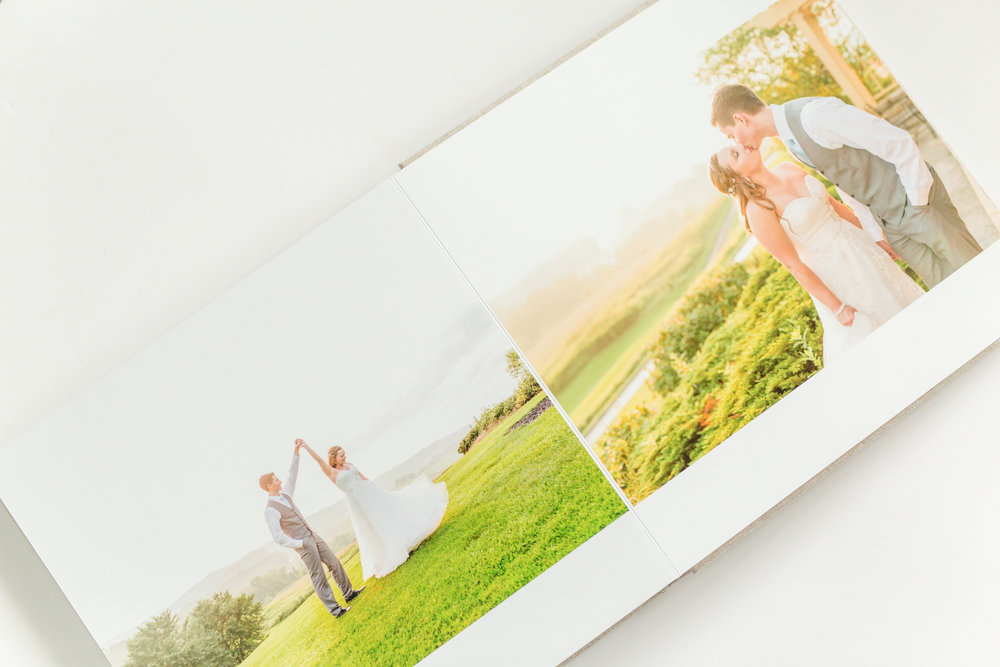 Heirloom Wedding Albums - Designed with you (and your grandchildren) in mind.These aren't the same albums your parent's wedding photos came in. They're modern, lay perfectly flat, and look incredible on coffee tables. They're the perfect conversation starter, and make great gifts.