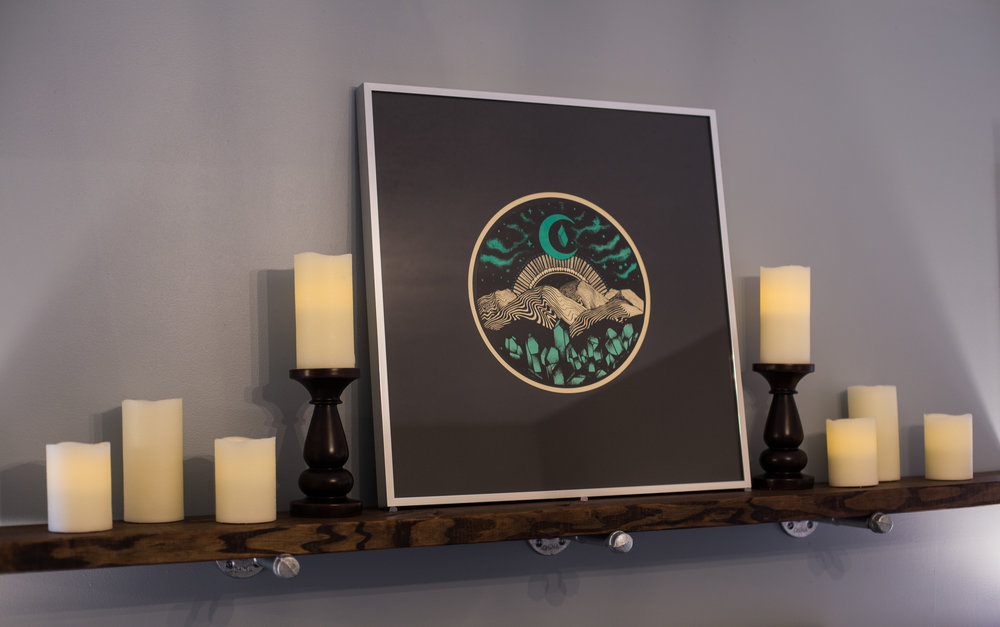 Local art helps create a peaceful ambiance in the master bedroom.