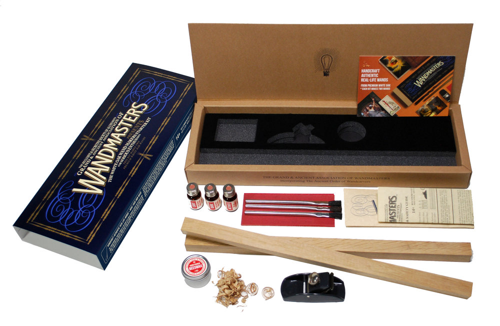 The Wandmasters' White Oak Starter Kit contains premium White Oak hardwood 16 inches x 2 pieces (makes two wands), contoured die-cast iron block plane with 1 inch adjustable blade, medium and extra-fine sanding sheets,Light and Dark traditional non-toxic food & skin-contact safe wood finishes and Aether varnish oil in 10 ml pharmaceutical-grade borosilicate glass vials, six inch horsehair brushes and natural hand-poured beeswax seal & polish in 1 oz. tin container, all packaged in a custom kraft frame box with hinged lid and color sleeve for storage.