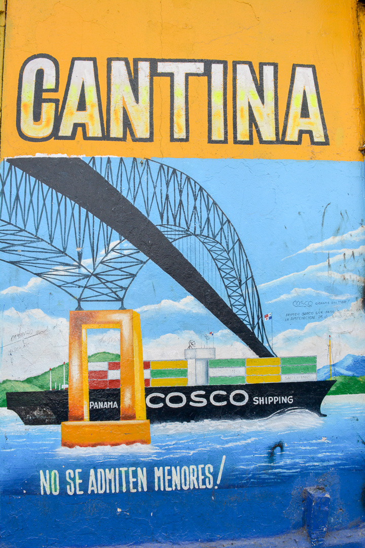 "Sign outside a cantina depicting the first ship that went through the new expanded set of locks in the Panama Canal...and also saying ""No minors allowed!"""