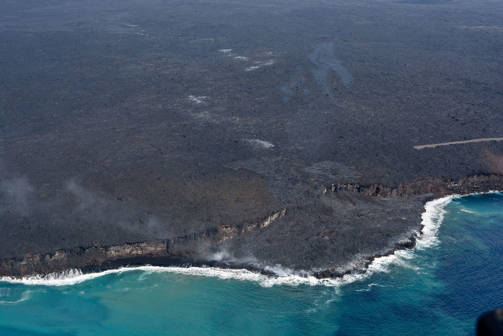Lava from Kilauea entering the ocean. You can see how lava flows create new land and change the Big Island's shoreline.