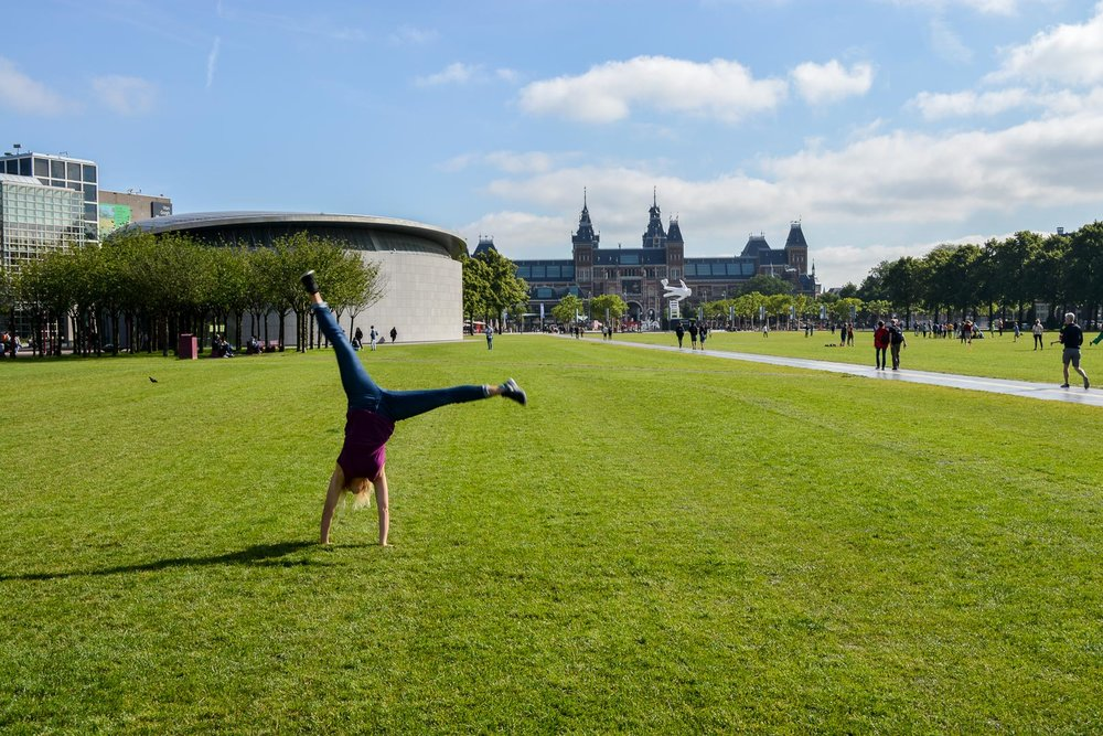 Doing cartwheels in front of the Rijksmuseum!