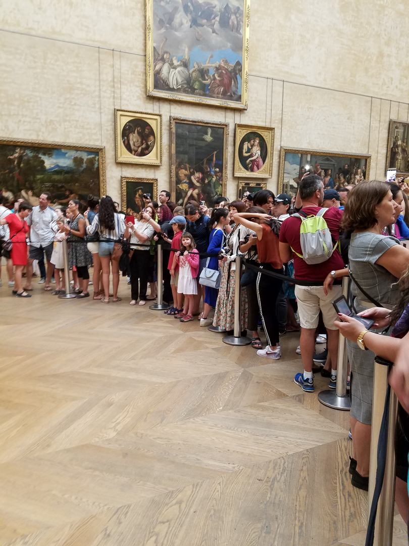 "Aaaand everyone trying to take a picture of or with ""Mona Lisa"""