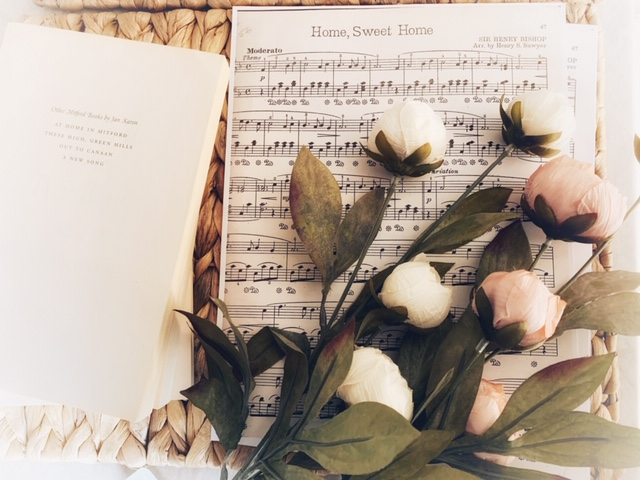 Books, sheet music, faux flowers