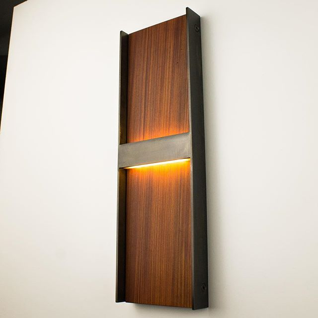 The WS 7 wall sconce has joined the Wood & Steel family. Darkened steel frame with solid Teak.  See it at www. papaydesigns.com  #madehere #modern #steel #style #interiordesign #interiordesigner #hoteldesign #moderndesign #lighting #lightingdesign #modern