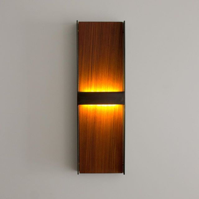 The WS7 available in #teak #walnut #whiteoak . Check out the #LED panels and diffusers tucked away under the #steel frame.. #madehere #interiordesign #interiordesigner #modern #lighting #lightingdesign #lighting_design #wallsconce