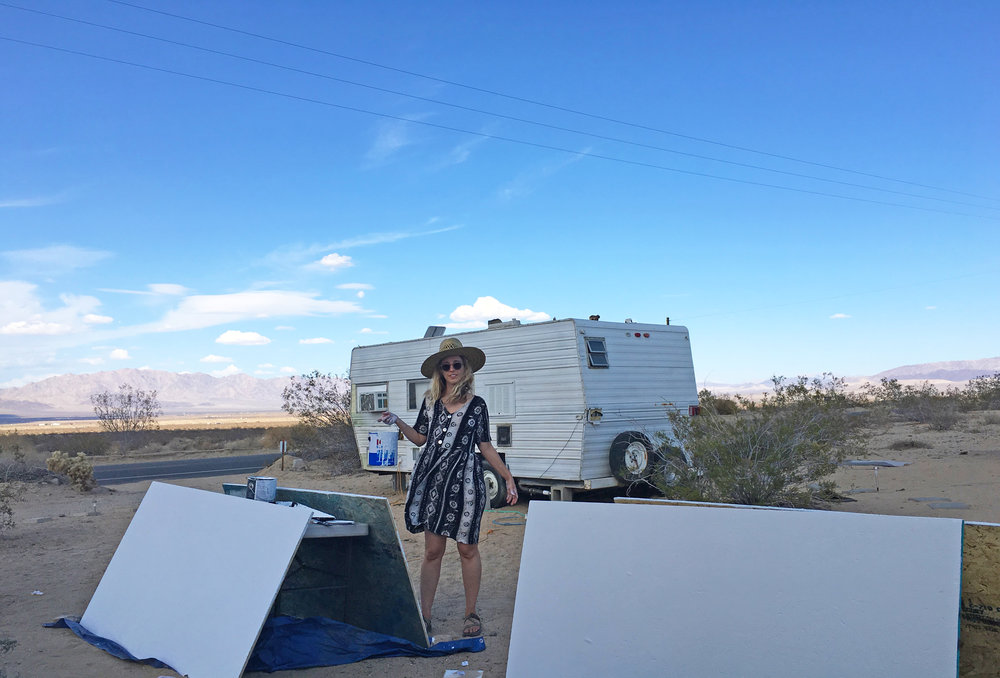 Katie Williams priming some wood on Highway 62, the main road through Joshua Tree, Twentynine Palms and Wonder Valley.