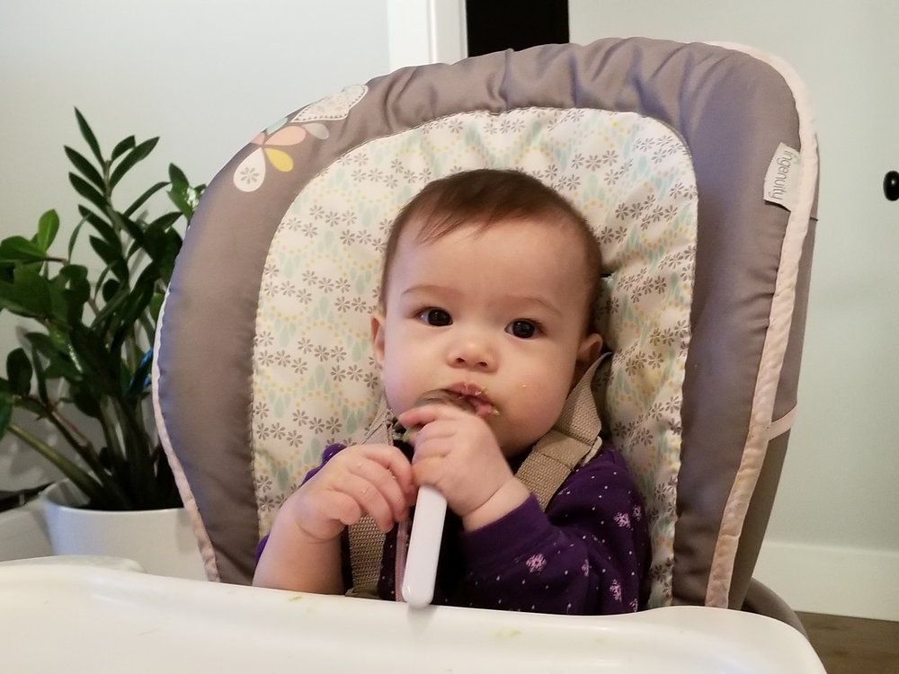 About 1 week into eating solids…she doesn't look that happy here, but she is a happy eater!