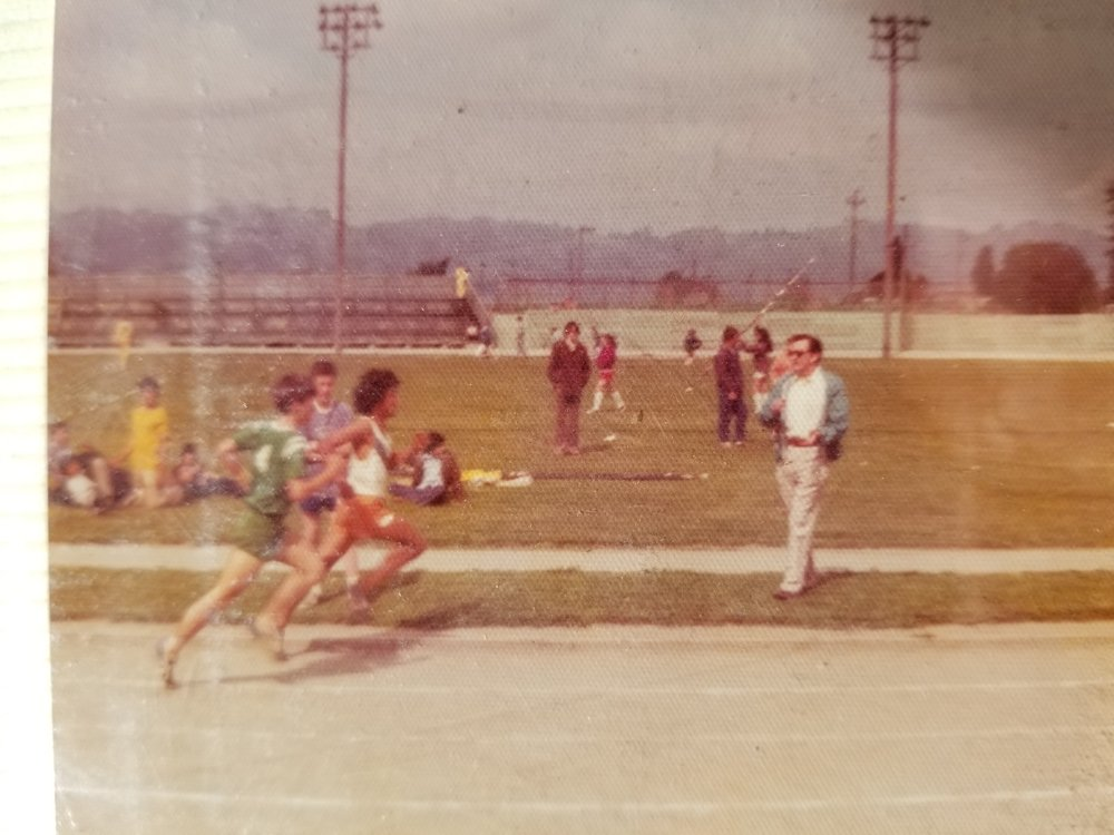 Regional Championships - 8th Grade. The Mile. I'm in the green. The man in the glasses is Johnny Coopwood, my grandfather, who is still alive at the age of 99.