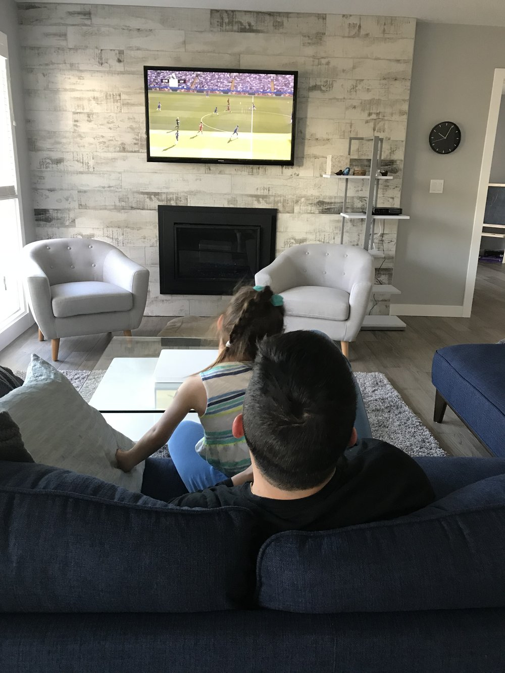 Maelle watching soccer with Daniel.