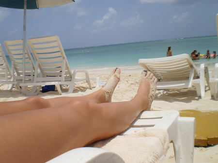 Photo: Cristina's legs (mine are much shorter) from one heck of a good vacation