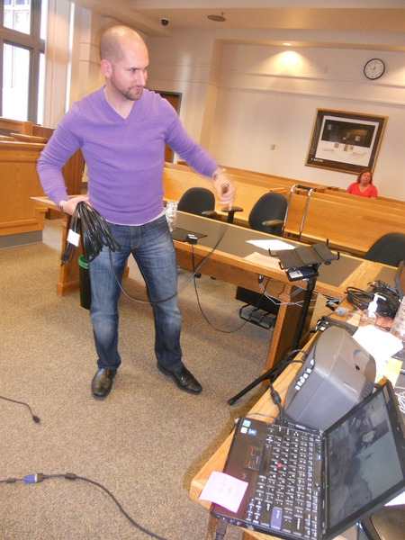 Photo:  John setting up trial equipment in King County Superior Court September 2012.
