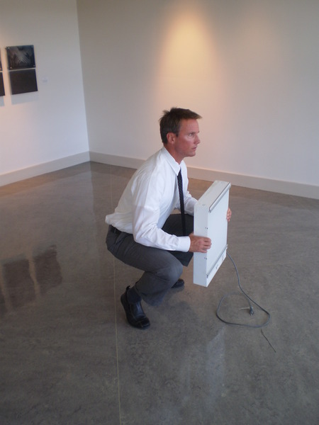 Photo: A chiropractor showing the jury the proper way the plaintiff needs to lift to protect his back while working in construction. Problem is he has a knee injury too. So now the jury can see the dilemma.