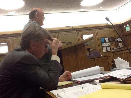 Photo: During the break in mediation today. Steve arguing in court. Paul studying up.