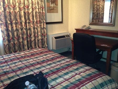 Photo: the dark, dank room with loud heater box in the corner.
