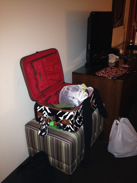 Photo:  You know things are bad when a neat nick like me, leaves the suitcase out like this.