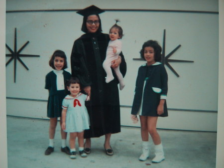 Photo:  MFK on graduation day from UW Law School in 1968 standing in front of our garage.  I was 8, Debbie 7, Susan 3, Jenny 1 and Greg was 7.5 months in utero.