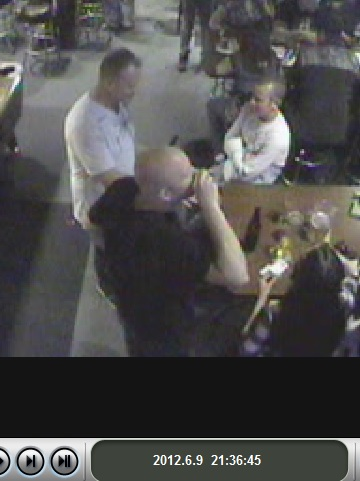 Photo:  Bar surveillance video capture of the drunk having another drink