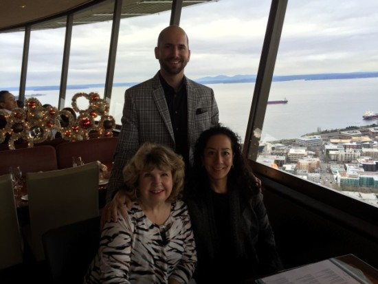 Photo:  John, Anne and I making the best of the trial date continuance by eating lunch at the space needle.