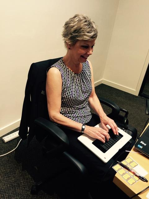 Photo: Jane with her light speed steno machine