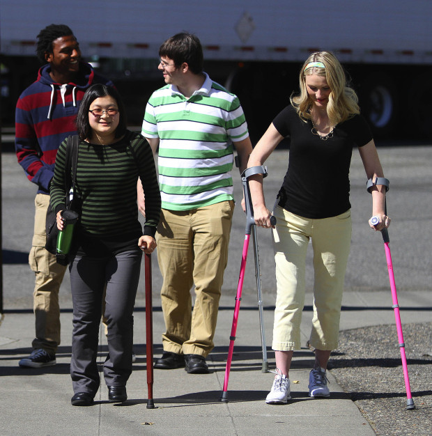 The surviving family members from a falling tree incident on U.S. 2 are seen leaving their lawyer's office in Seattle on Friday. From left: Jeremy Owen, Jaime Mayer, Steven Mayer, and Jessica Owen.  (John Lok / The Seattle Times)