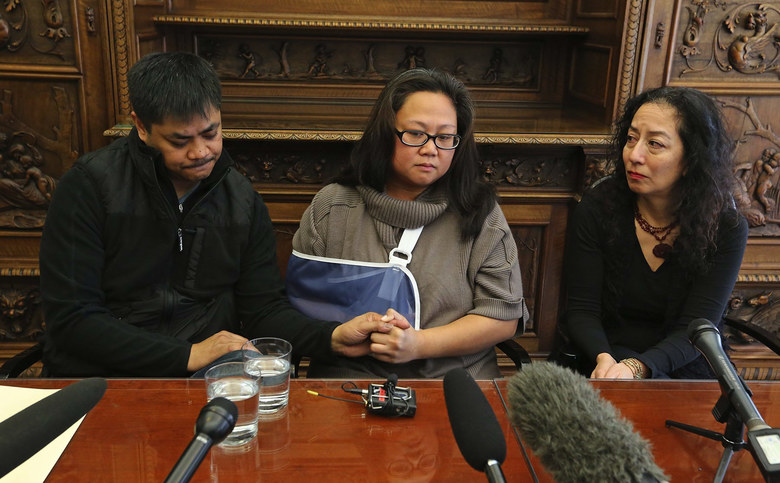 Michelle Mallari holds a press conference at her lawyer's office. Mallari was shot while watching a movie in Renton. (Greg Gilbert / The Seattle Times)
