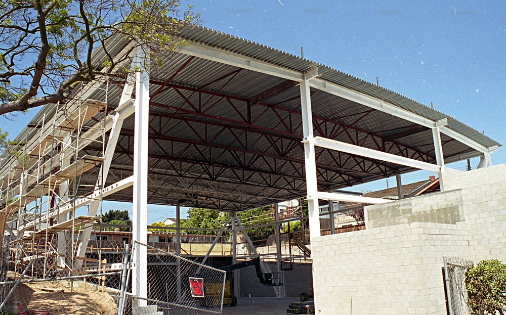 - The building in construction. The steel frame was left exposed in the interior of the structure
