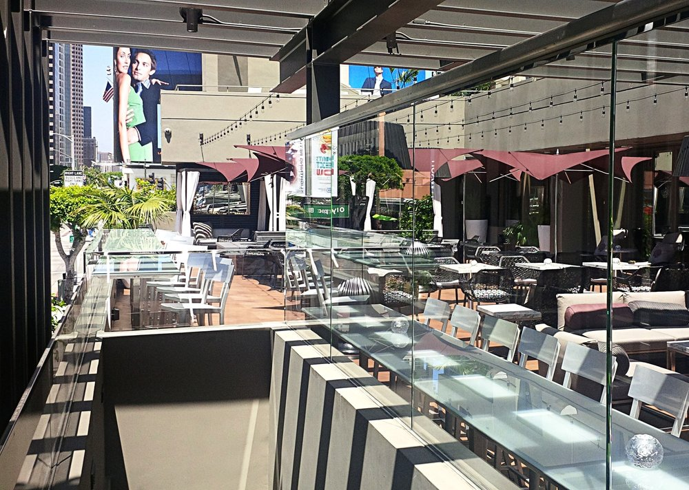 - Looking north across the patio. Counter seating is placed along the Figueroa frontage.